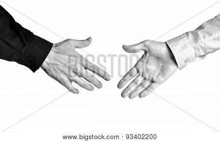 Bold contrast black and white of businessmen showing trust in a deal with a handshake