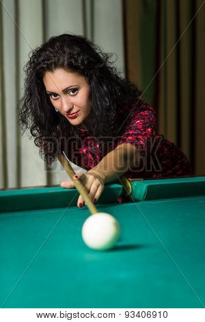 Young Brunnete Woman Aiming To Ball Playing Billiard.