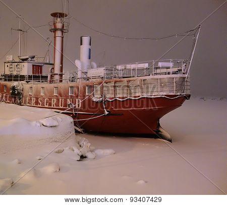 Lightship Relandersgrund in a snow storm in the center of Helsinki, Finland