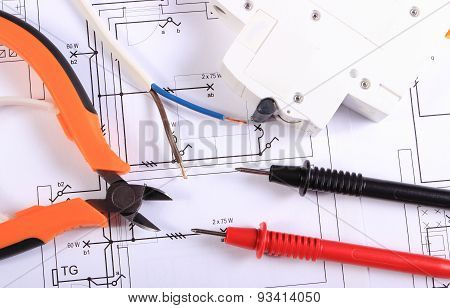 Cables Of Multimeter, Pliers, Electric Fuse And Wire On Construction Drawing