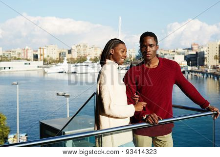 Portrait of romantic young couple enjoying view at Barcelona during their spring holidays