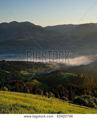 Mountain Village At Sunset In
