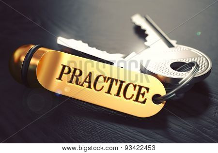 Practice - Bunch of Keys with Text on Golden Keychain.