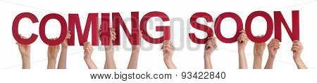 People Hands Holding Red Straight Word Coming Soon