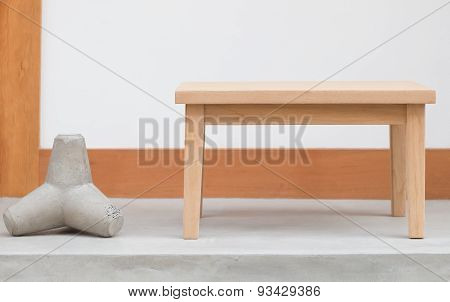 Simple brown wood table and white concrete wall