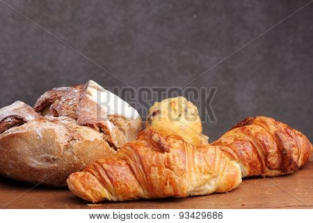 sour dough bread croissant muffin on teakwood table poster