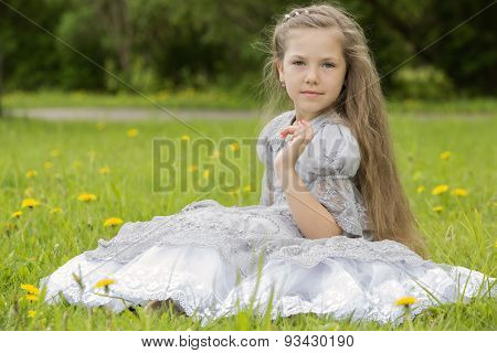 Girl Sitting In The Park And Posing
