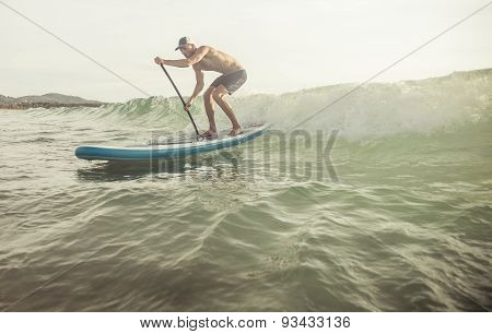 Surfer With Paddle Board