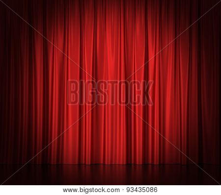 Red silk curtains for theater and cinema spotlit light in the center.
