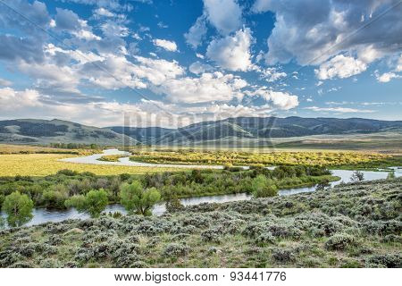 meanders of North Platte River above Northgate Canyon, North Park, Colorado - early summer scenery with partially cloudy sky