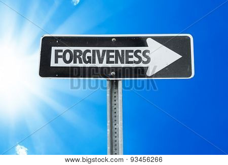Forgiveness direction sign with a beautiful day