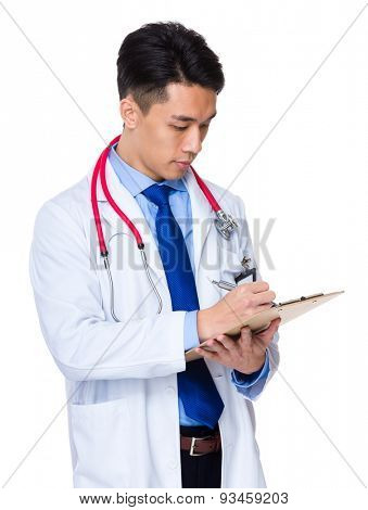 Male doctor jotting down the case of patient