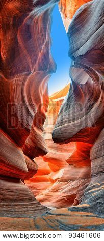 Sunlight reflected off of the red rock curves of the Antelope Canyon Slot Canyons in Page, Arizona.