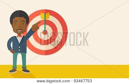 A black salesman happy standing while his hand pointing to the arrow from target pad shows that he hit his target sales. Business concept. A Contemporary style with pastel palette, soft beige tinted