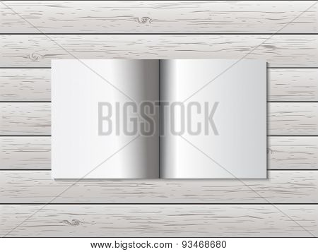 Open book on wooden table