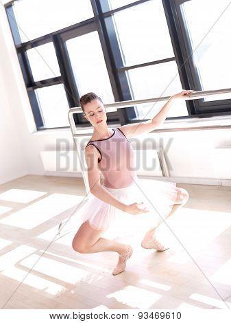Young Ballerina Doing Plie In Sunny Dance Studio