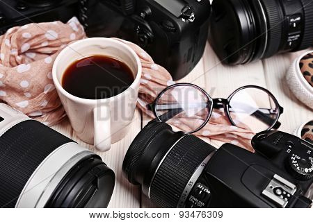 Still life with modern cameras on wooden table, closeup