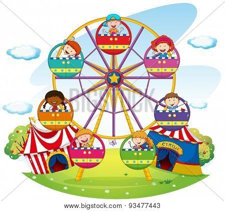 Children riding on ferris wheel  in the park