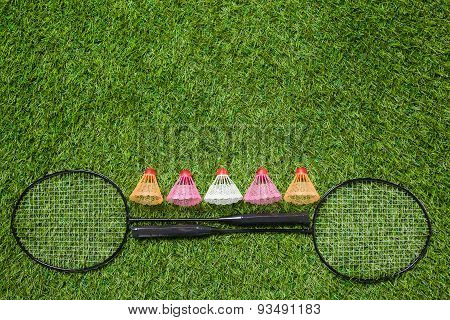 Two badminton rackets with color shuttlecocks