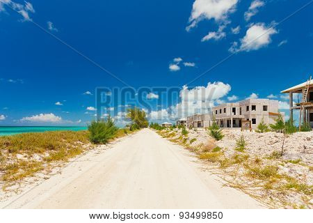 Pathway Along The Seaside And Abandoned Houses