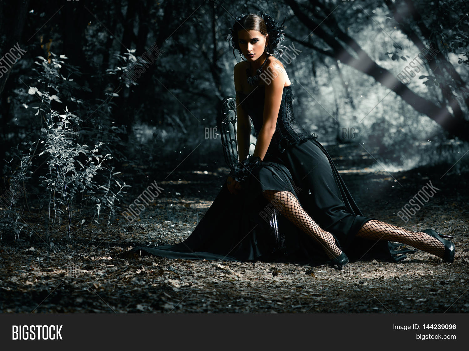 Beautiful Gothic Woman Wearing Long Black Dress Posing In A Mystic Forest Medieval History