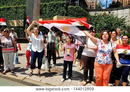 New York City - July 30, :2013:  Egyptians demonstrating in Dag Hammerskjold Plaza across the street from the United Nations in support of the Army which deposed President Morsi's Islamic Brotherhood government