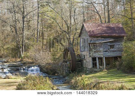Historic mid-1800s Laudermilk grist mill next to a stream - Habersham County Georgia
