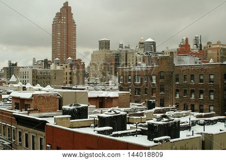 New York City - March 1 2005: View overlooking snow-covered rooftops on the Upper West Side of Manhattan following a winter snowstorm