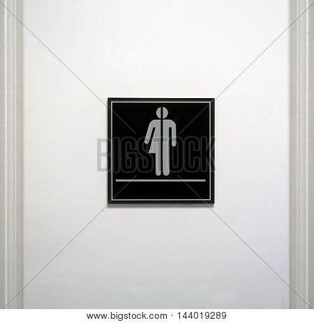Restroom sign with blank space under the gender neutral symbol.