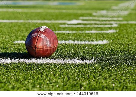 Football on Yardage Marker. Low Angle. Horizontal View