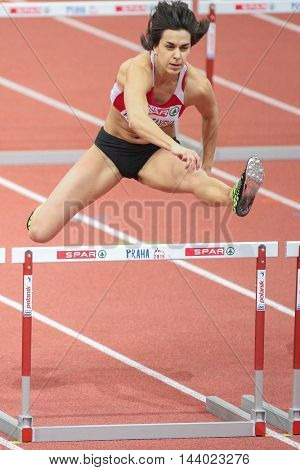 PRAGUE, CZECH REPUBLIC - MARCH 6, 2015: Katsiaryna Netsviatayeva (#516 Belarus) competes in the women's 60m hurdles event of the European Athletics Indoor Championship.