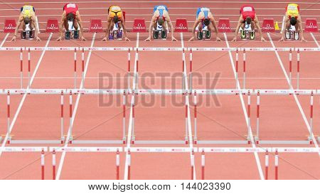 PRAGUE, CZECH REPUBLIC - MARCH 8, 2015: Ilya Shkurenyov (#311 Russia) competes in the men's 60m hurdles event of the European Athletics Indoor Championship.