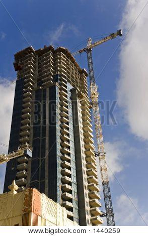 Skyscraper And Crane