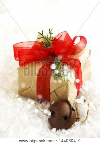 Christmas gift box with red bow and bell