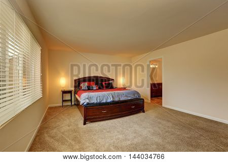 Soft Beige Bedroom Interior. Wooden Bed With Drawers.