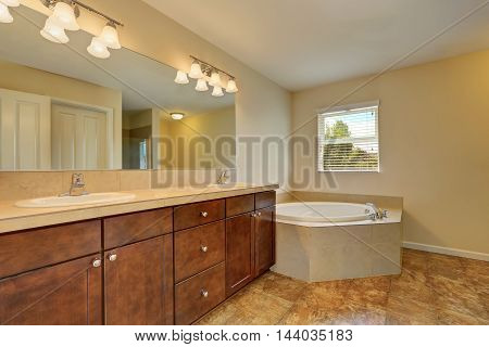 Great Bathroom Interior With Corner Bath Tub And Marble Floor