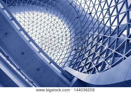 Abstract architectural background. Toned in blue color
