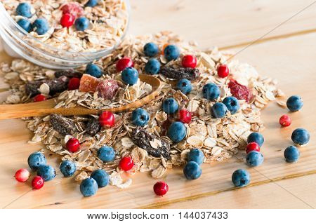 Serving Muesli With Scattering Of Wild Berries On Wooden Table