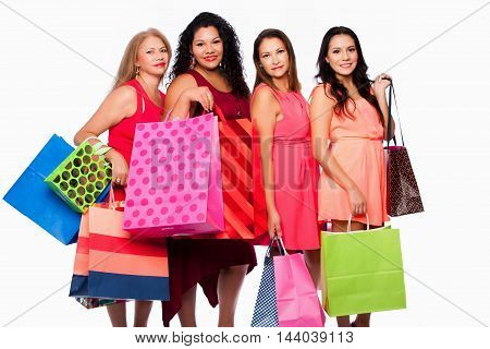 Beautiful happy Group of friends women standing with colorful shopping bags consumer lifestyle concept.