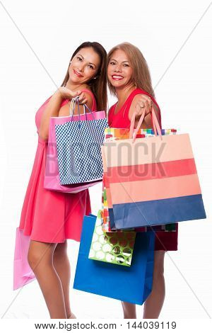 Beautiful happy friends mother daughter women standing together with colorful shopping bags consumer lifestyle concept.