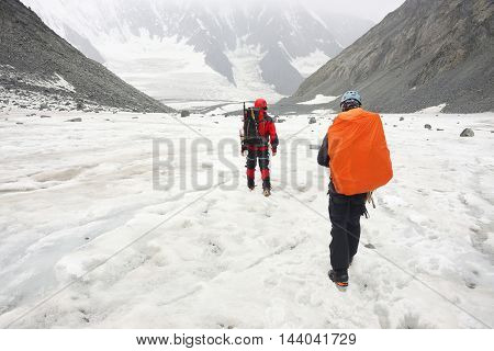 Alpinists traversing Akkem Glacier in Altai Mountains, Russian Federation