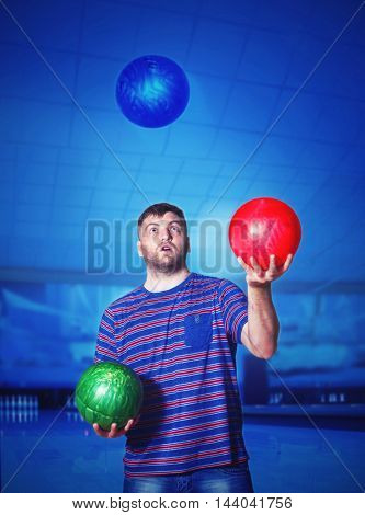 Man with bowling balls