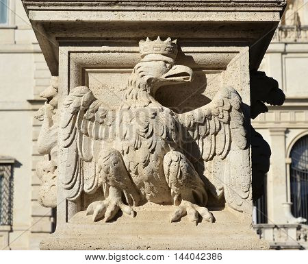 Crowned eagle emblem of House of Borghese noble italian family from baroque balustrade in Villa Borghese public park Rome