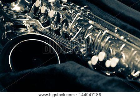 saxophone jazz musician closeup in dark light