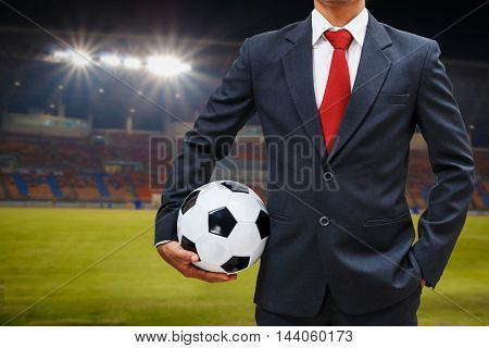 soccer manager in the stadium holding soccer ball