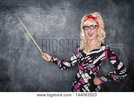 Happy Retro Teacher In Glasses With Wooden Pointer
