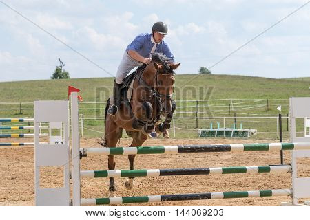 SVEBOHOV CZECH REPUBLIC - AUG 20: Front view of horseman in blue jumping on a brown horse at