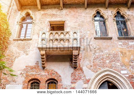 Verona, Italy - May 22, 2016: Famous Romeo and Juliet balcony. This house is the main tourist attraction in Verona. Romeo and Juliet is a tragedy written by William Shakespeare