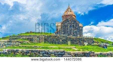 SEVAN ARMENIA - MAY 31 2016: The medieval Sevanavank Monastery located on the Sevan Peninsula and washed by waters of Sevan Lake on May 31 in Sevan