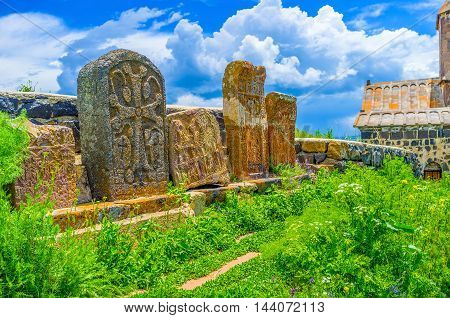 The preserved khachkars on the medieval cemetery between the churches of Sevanavank Monastery Sevan Armenia.